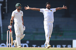 July 14, 2017 - Colombo, Sri Lanka - Zimbabwe cricketer Craig Ervine (L) looks on  as Sri Lanka's Lahiru Kumara appeals unsuccessfully   during the first day of the only Test cricket match between Sri Lanka and Zimbabwe at ..R Premadasa International Cricket Stadium,in the capital city, Colombo, ..Sri Lanka on Friday 14 th July 2017  (Credit Image: © Tharaka Basnayaka/NurPhoto via ZUMA Press)