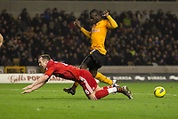 20120131: WOLVERHAMPTON, UK - Barclays Premier League 2011/2012: Wolverhampton Wanderers vs Liverpool.<br /> In photo: Charlie Adam of Liverpool falls under a challenge from Emmanuel Frimpong of Wolverhampton Wanderers but fails to earn a penalty.<br /> PHOTO: CITYFILES