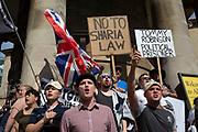 Free Tommy Robinson demonstrators shout slogans at their opposition organised by anti-fascist groups including Stand up to Racism opposed to far right politics on 24th August 2019 in London, United Kingdom. Some 250 Stand Up To Racism and other anti-fascist groups took to the streets today in opposition to supporters of jailed 'Tommy Robinson' real name Stephen Yaxley-Lennon at Oxford Circus, who gathered outside the BBC.