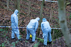 "© Licensed to London News Pictures. 07/12/2019. Gerrards Cross, UK. Forensic investigators look into a concrete pit indicated with an evidence identification marker as London's Metropolitan Police Service searches woodland in Gerrards Cross, Buckinghamshire. Police have been in the area conducting operations since Thursday 5th December 2019 and are searching two areas on Hedgerley Lane. In a press statement a Metropolitan Police spokesperson said ""Officers are currently in the Gerrards Cross area of Buckinghamshire as part of an ongoing investigation.<br /> ""We are not prepared to discuss further for operational reasons.""<br /> Photo credit: Peter Manning/LNP"