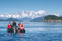 Tourists looking the Fairweather Range across Cross Sound from the Inin Islands in Cross Sound, Alaska.