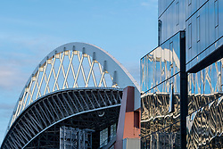 United States, Washington, Seattle, roof of Safeco Field stadium and glass office tower.