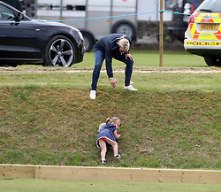 The Queen's granddaughter Zara Tindall rushes to the rescue of her daughter Mia at the Gloucestershire Polo Festival.<br /> <br /> Mia had become detached from the group and had started to cry while holding her cuddly toy. Zara was nearby talking to her sister in law Autumn Phillips and when she saw what had happened she ran down a grass bank to her daughter and scooped her up for a cuddle.<br /> 