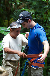 Mayer Attaching Safety Straps To Jared Before Heading Up Canopy Tower, Tiputini