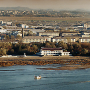 Sinuiju city, North Korea, 11-2003..An overview of Sinuiju, a North Korean city of 300,000 people bordering China. . .North Korea is the world's most insular and totalitarian state. Ruled by the messianic leader Kim Il Sung and his son Kim Jong Il since 1948, North Korea has stubbornly stuck to its juche (self-reliance) ideology and siege mentality, imposing one Stalinist economic plan after another. Floods, droughts and mismanagement in the 1990s plunged the country into a preventable famine, killing up to three million, or 13 percent of the population. It now depends heavily on Chinese aid...