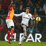 Galatasaray's Dany Achille Nounkeu Tchounkeu (L) and Besiktas's Mehmet Akyuz (R) during their Turkish superleague soccer derby match Galatasaray between Besiktas at the TT Arena at Seyrantepe in Istanbul Turkey on Sunday, 27 January 2013. Photo by Aykut AKICI/TURKPIX