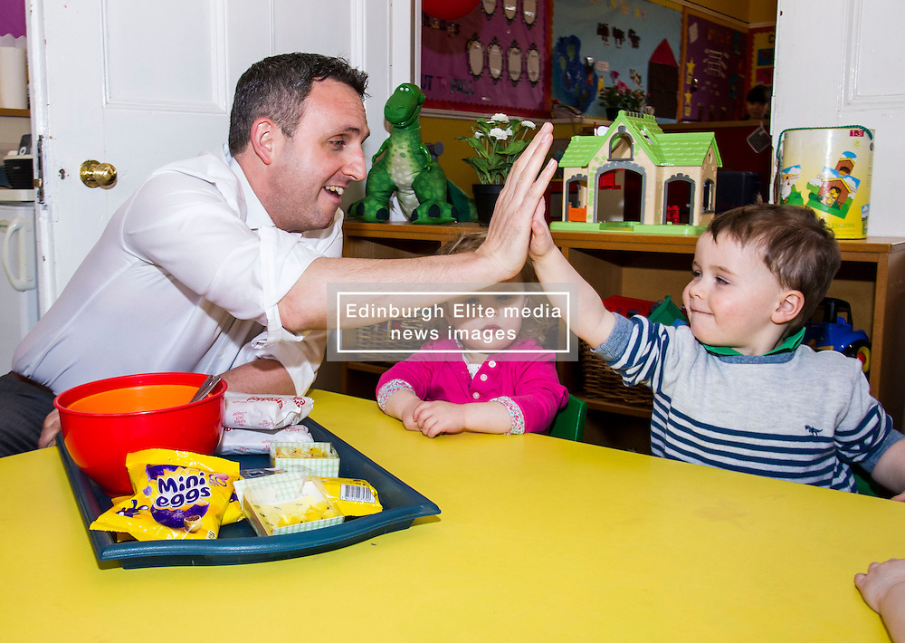 Pictured: Alex Cole-Hamilton, Scottish Liberal Democrat candidate for Edinburgh Western high fives Nico Mills<br /> <br /> Scottish Liberal Democrat leader Willie Rennie marked the first full day of campaigning for the Scottish Election by visiting  the New Town Nursery in Edinburgh. He was joined by Edinburgh Western candidate Alex Cole-Hamilton as the children were enjoying a lively morning<br /> <br /> Ger Harley | EEm 23 March 2016