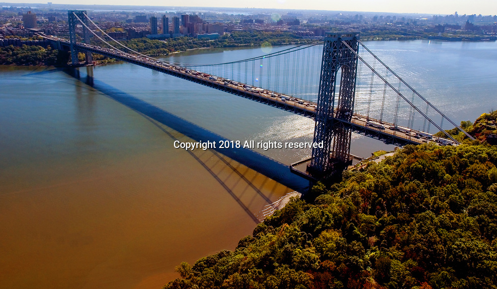 Aerial view of the George Washington Bridge during rush hour. View East towards Manhattan from New Jersey.  Hudson River in middle.