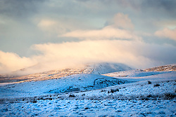 © Licensed to London News Pictures. 25/11/2017. Gearstones UK. Snow covered Whernside mountain on Newby Head pass in Gearstones this morning after a night of snow fall in the Yorkshire Dales. Photo credit: Andrew McCaren/LNP