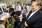 Airbus A380 first commercial flight - Singapore Airlines SQ 380 Singapore-Sydney on October 25, 2007. William Leong (r), whose 91-year-old father (m.) was the oldest person on board, paid US $55,000 to take his family of eight on the historic flight.
