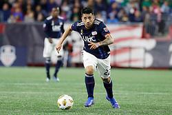 September 22, 2018 - Foxborough, MA, U.S. - FOXBOROUGH, MA - SEPTEMBER 22: New England Revolution forward Guillermo Hauche (22) pushes the ball forward during a match between the New England Revolution and the Chicago Fire on September 22, 2018, at Gillette Stadium in Foxborough, Massachusetts. The teams played to a 2-2 draw. (Photo by Fred Kfoury III/Icon Sportswire) (Credit Image: © Fred Kfoury Iii/Icon SMI via ZUMA Press)
