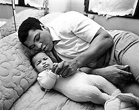 Muhammed Ali, World Heavyweight boxing champion, seen with his baby daughter Hana at his Chicago home, USA.February 1977.Photo by Terry Fincher