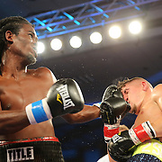 ORLANDO, FL - OCTOBER 04: Berthin Rousseau (L) catches Jovan Perez with a left hook  during a professional boxing match at the Bahía Shriners Auditorium & Events Center on October 4, 2014 in Orlando, Florida. Perez would go on to win the fight. (Photo by Alex Menendez/Getty Images) *** Local Caption *** Felix Verdejo; Sergio Villanueva