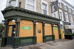 © Licensed to London News Pictures. 04/07/2020. London, UK. The Albert pub in Primrose hill , North London, remains boarded up, despite Pubs, bars, cafes and restaurants being allowed to fully open for the first time since lockdown. Photo credit: Ben Cawthra/LNP