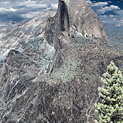Yosemite National Park's most well-know feature is Half Dome, which stands at an altitude of 8,836 feet and 4,737 feet above the valley floor. As the rock was exposed, weathering and exfoliation of shell-like outer layers of the rock shaped the dome portion of the rock to its current shape. The summit is attainable as a day hike in the summer, if you have the stamina to undertake a 17-mile roundtrip hike with 5000 feet of elevation gain from the valley floor...This is a digital combination of an infrared image and a visible color image.  The color picture is used to colorize the infrared image giving a foreign and new perspective.  Plants and trees reflect more infrared light and appear brighter in images while the sky reflects less making it darker.