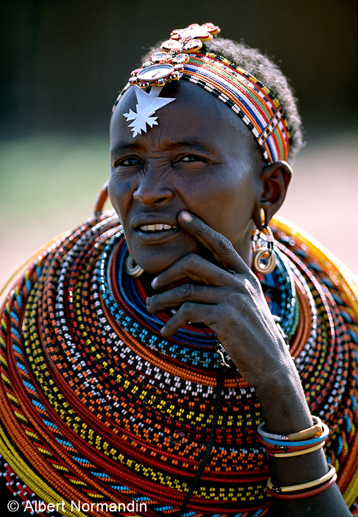 Maasai woman covered in beads and head dress with silver arrow