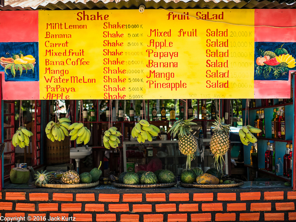18 JUNE 2016 - DON KHONE, CHAMPASAK, LAOS:  A fruit shake shop on Don Khone. Don Khone Island, one of the larger islands in the 4,000 Islands chain on the Mekong River in southern Laos. The island has become a backpacker hot spot, there are lots of guest houses and small restaurants on the north end of the island.    PHOTO BY JACK KURTZ
