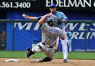April 30, 2008:  Shortstop Mike Aviles #30 of the Kansas City Royals makes a throw for a double play over base runner Travis Snider #45 of the Toronto Blue Jays during the seventh inning at Kauffman Stadium in Kansas City, Missouri.  The Royals defeated the Blue Jays 8-6...