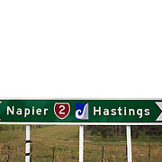 The distinctive blue Pacific Coast Highway sign on a Napier to Hastings sign post near Hastings. North Island, New Zealand. 13th January 2010 Photo Tim Clayton.