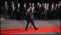 President Barack Obama and The  First Lady Michelle Obama leave  Downing Street after the G20 Leaders dinner watched carefully by the close protection officers,London April 1, 2009, REUTERS/Andrew Parsons