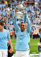 Danilo (3) of Manchester City holds up the FA Cup at full time  during the The FA Cup Final match between Manchester City and Watford at Wembley Stadium, London, England on 18 May 2019.