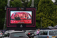 Warwick Castle Presents its first drive in cinema provided by Luna Drive in Cinema in partnership with Mitsubishi<br /> Staff hand customers in car speakers<br /> Food delivered in a Deliveroo style to cars<br /> one customer arrived in a Jurassic Park custom Jeep