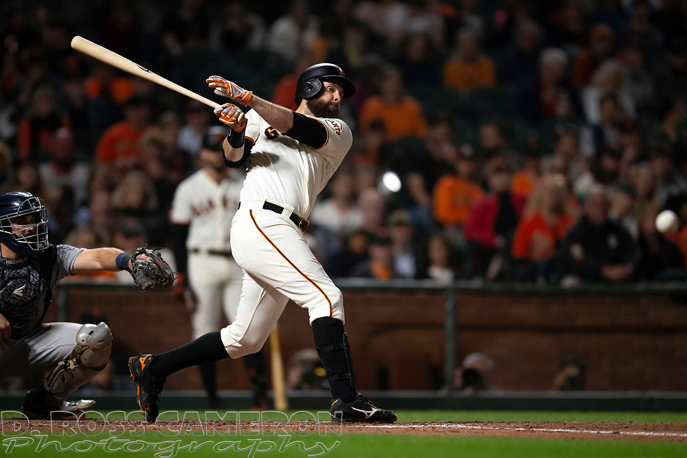 San Francisco Giants' Brandon Belt (9) fouls off a pitch against the San Diego Padres during the eighth inning of a baseball game, Thursday, Aug. 29, 2019, in San Francisco. The Padres won 5-3. (AP Photo/D. Ross Cameron)