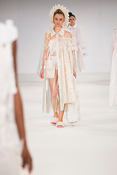 © Licensed to London News Pictures. 31/05/2015. London, UK. Collection by Laura Roberts. Fashion show of UCA Epsom at Graduate Fashion Week 2015. Graduate Fashion Week takes place from 30 May to 2 June 2015 at the Old Truman Brewery, Brick Lane. Photo credit : Bettina Strenske/LNP