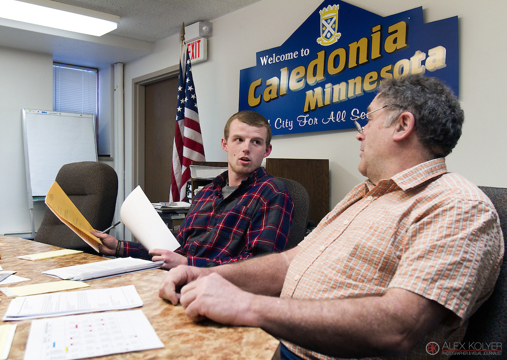 Josh Gran, left, talks with Robert Burns before the start of the Caledonia city council meeting Monday, March 9, 2015. Gran is the newly elected mayor of Caledonia, and is the youngest in the city's history. The 21-year-old is also a student at the University of Wisconsin, La Crosse and has to balance his political life with his student life. Burns is the former mayor of Caledonia, and now sits on the council.