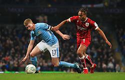 Kevin De Bruyne of Manchester City takes on Bobby Reid of Bristol City - Mandatory by-line: Matt McNulty/JMP - 09/01/2018 - FOOTBALL - Etihad Stadium - Manchester, England - Manchester City v Bristol City - Carabao Cup Semi-Final First Leg