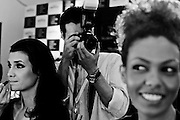 A photographer working with models back stage