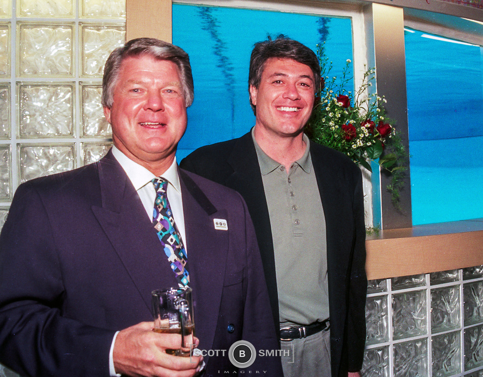 Former NFL head coach Jimmy Johnson and former Miami Dolphins receiver Jimmy Cefalo share laughs during his private Super Bowl XXIX party inside his newly opened Three Rings Bar and Grill at the Eden Roc Hotel and Resort, Maimi Beach, 1995.
