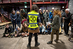 © Licensed to London News Pictures. 16/03/2019. Bristol, UK. Participants train in non violent direct action at the Extinction Rebellion (XR) Spring Uprising training weekend at Motion nightclub in Bristol, an event in preparation for the International Rebellion on April 15th. Speakers included Satish Kumar and XR groups held workshops and trained in non-violent direct action to create disruption and cause change. The event it also to celebrate and strengthen the movement, and get skilled up and organised for the International Rebellion on April 15th. Photo credit: Simon Chapman/LNP
