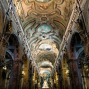 The ornately decorated ceiling of the Metropolitan Cathedral of Santiago (Catedral Metropolitana de Santiago) in the heart of Santiago, Chile, facing Plaza de Armas. The original cathedral was constructed during the period 1748 to 1800 (with subsequent alterations) of a neoclassical design.