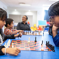 Sieanna Johnson, 9, left, and Joel Denetclaw, 7, play chess Wednesday, May 22 during Chess Club at the Octavia Fellin Public Library Children's Branch.
