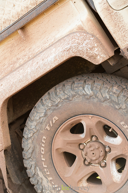 Close-up of the dirty wheel and the side of a safari 4x4 car, Ngorongoro Crater, Tanzania