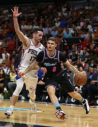 November 12, 2018 - Miami, FL, USA - The Heat's Tyler Johnson drives past the 76ers' J.J. Reddick in the first quarter as the Miami Heat host the Philadelphia 76ers on Monday, Nov. 12, 2018 at American Airlines Arena in Miami. (Credit Image: © Patrick Farrell/Miami Herald/TNS via ZUMA Wire)