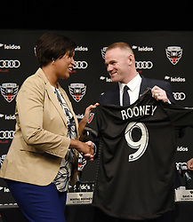 English international soccer player Wayne Rooney and Mayor of Washington, D.C. Muriel Bowser attend the media unveiling at the Newseum in Washington