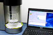Integrated syringe liquid sampler and optical particle counting system with software interface.