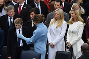 Melania Trump adjusts the tie of son Baron Trump as Tiffany Trump and Ivanka Trump look on during the President Inaugural Ceremony on Capitol Hill January 20, 2017 in Washington, DC. Donald Trump became the 45th President of the United States in the ceremony.