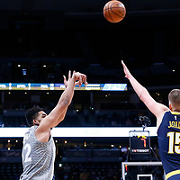 05 April 2018: Minnesota Timberwolves center Karl-Anthony Towns (32) takes a jump shot over Denver Nuggets center Nikola Jokic (15) during the Denver Nuggets 100-96 victory over the Minnesota Timberwolves, at the Pepsi Center, Denver, Colorado, USA.
