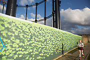 Hoarding in front of the construction site in King's Cross, London, UK where an old re-erected Victorian Gasholder No 8 stands. The Grade II-listed structure, built in the 1850s, has been restored over the last two years.