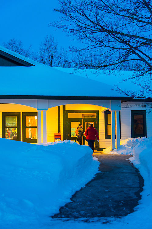 Participants in the Michigan DNR Becoming an Outdoors Woman program stroll the wintry grounds at Bay Cliff Health Camp in Big Bay, Michigan.