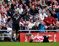 Photo: Jed Wee.<br />Sunderland v West Bromwich Albion. The Barclays Premiership. 17/09/2005.<br /><br />Sunderland manager Mick McCarthy (L) raises his arms in frustration as yet another of his players is sent to the ground in agony by a crunching West Brom challenge.