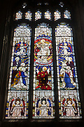 Saints in stained glass in Long Melford's Holy Trinity Church, Suffolk. The Church of the Holy Trinity, Long Melford is a Grade I listed parish church of the Church of England in Long Melford, Suffolk, England. It is one of 310 medieval English churches dedicated to the Holy Trinity. The church was constructed between 1467 and 1497 in the late Perpendicular Gothic style. It is a noted example of a Suffolk medieval wool church, founded and financed by wealthy wool merchants in the medieval period as impressive visual statements of their prosperity.