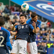 PARIS, FRANCE - September 10:   Leo Dubois #13 of France and Raphaël Varane #4 of France combine to defend a throw in during the France V Andorra, UEFA European Championship 2020 Qualifying match at Stade de France on September 10th 2019 in Paris, France (Photo by Tim Clayton/Corbis via Getty Images)