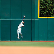 Denard Span of Minnesota makes a leaping catch..The Minnesota Twins defeated the Cleveland Indians 4-2 on Sunday, July 27, 2008 at Progressive Field in Cleveland.
