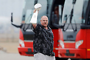 Kansas City Chiefs head coach Andy Reid holds up the Lombardi Trophy as his team returns home a day after winning the NFL Super Bowl 54 football game, Monday, Feb. 3, 2020, in Kansas City, MO. The Chiefs defeated the San Francisco 49ers 31-20, to win their first championship in 50 years.  (AP Photo/Colin E. Braley)