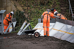 © Licensed to London News Pictures. 01/02/2021. Weybridge, UK. Workers begin installing flood defences along the river Thames at Weybridge in Surrey. Extra precaution is being taken because In 2014 Weybridge and the surrounding area was badly hit by flooding. Photo credit: Ben Cawthra/LNP