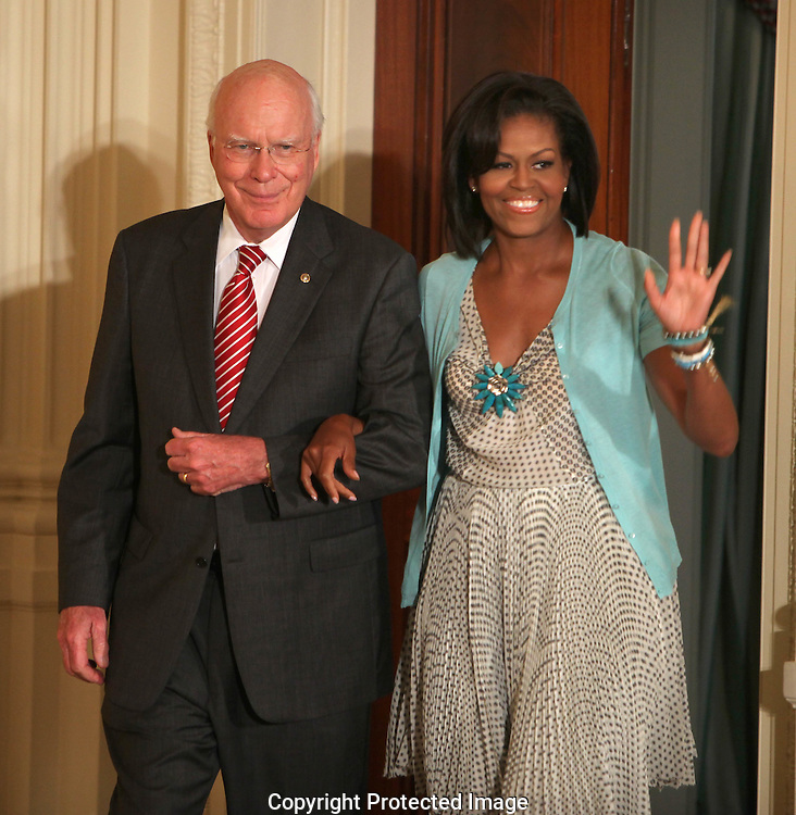 Senator Patrick Leahy, D-VT and First Lady Michelle Obama enter the East Room of the White House at a reception for Supreme Court Justice Sonia Sotomayor on August 12, 2009.  Photo by Dennis Brack